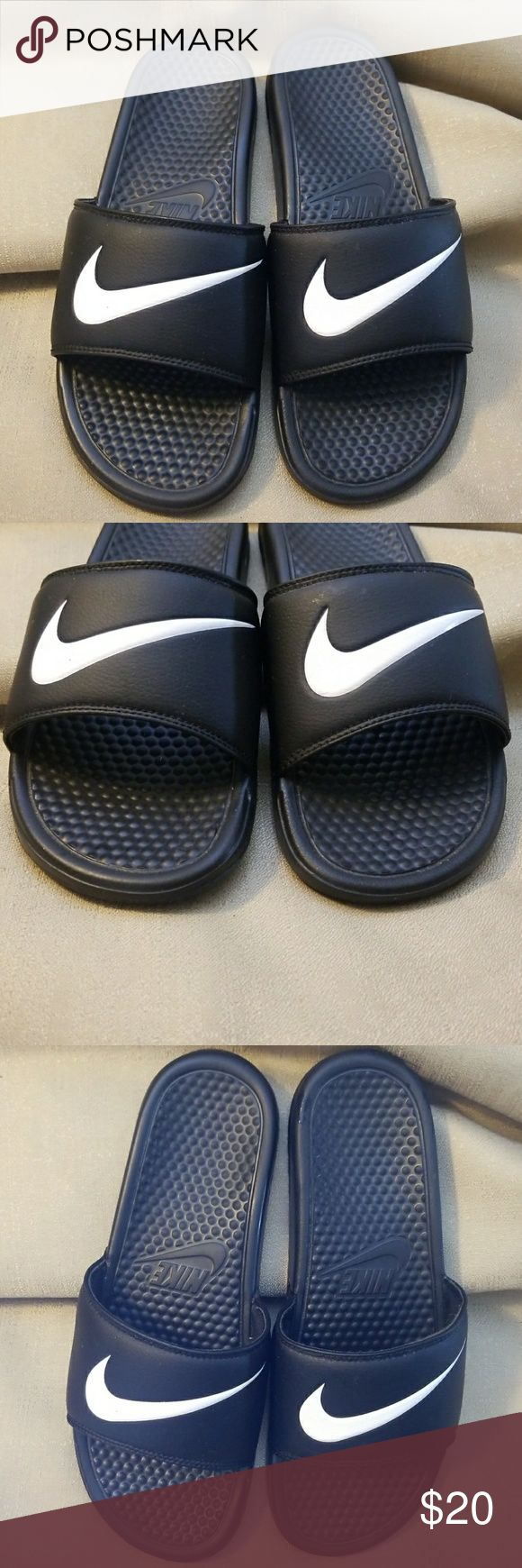 Nike men's slip on black sandals open toe size 10 Very good used condition size 10 Nike black slip on sports sandals. Minimal wear. Has the circular raised inner sole for foot comfort. Nike Shoes Sandals & Flip-Flops
