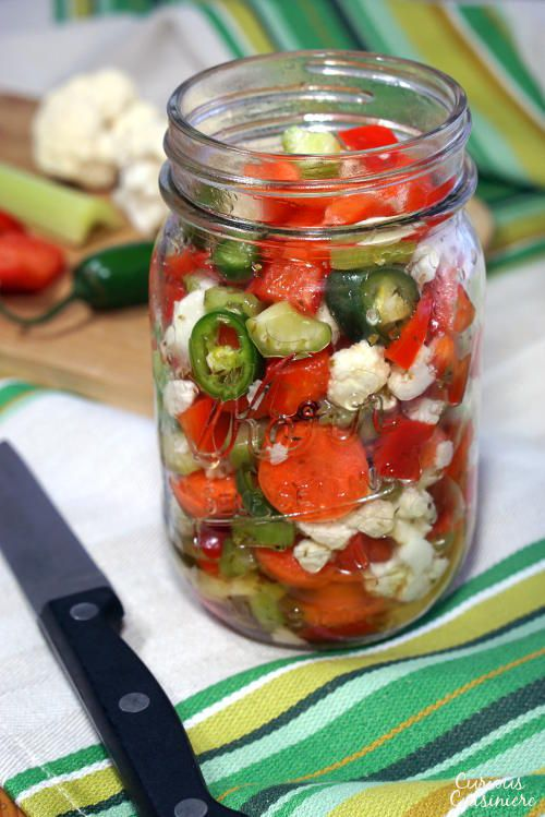 Our homemade Giardiniera recipe gives you the freedom to choose your level of heat. These Italian pickled vegetables are the perfect, crisp sandwich topper and much more!   www.CuriousCuisiniere.com