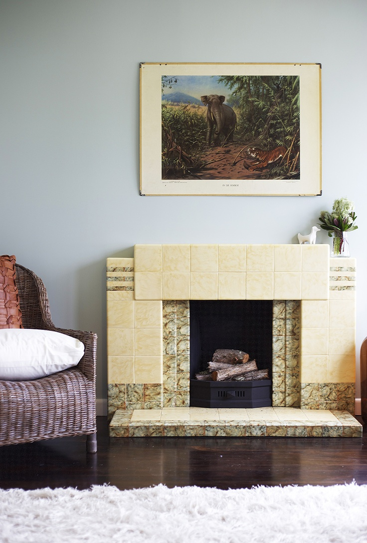 Home Staging by Places & Graces. Art Deco fireplace. Vintage jungle print, The Vitrine. Blue, brown, white.