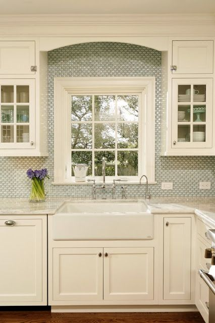 Like: cabinet style, trim/wood work above window; small tile as ...