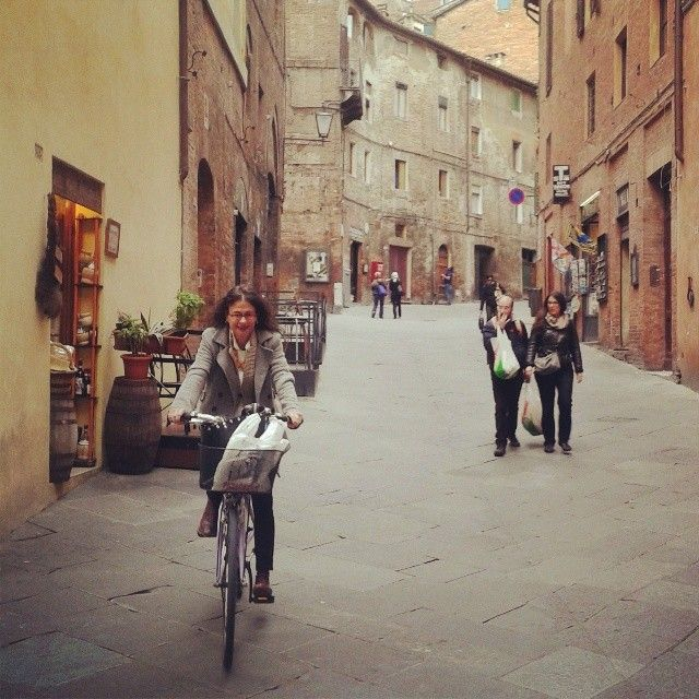Only cyclist around. Writer Nina Burleigh on her rented bike in Siena.