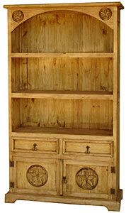 Three shelves, two drawers and a large carved star cabinet make this southwestern style bookcase essential for office, den, or library ...anywhere you need storage or display shelves. You can even use this in the kitchen to show off your decorative plates and to store linens. This very affordable and attractive piece of handmade furniture is topped off with a curved bonnet.   LaFuente.com