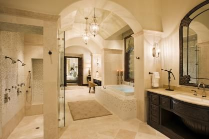 """A bathroom """"Suite"""" with his/her sinks, huge double standing showers, jacuzzi tub, and a separate toilet 'room'"""