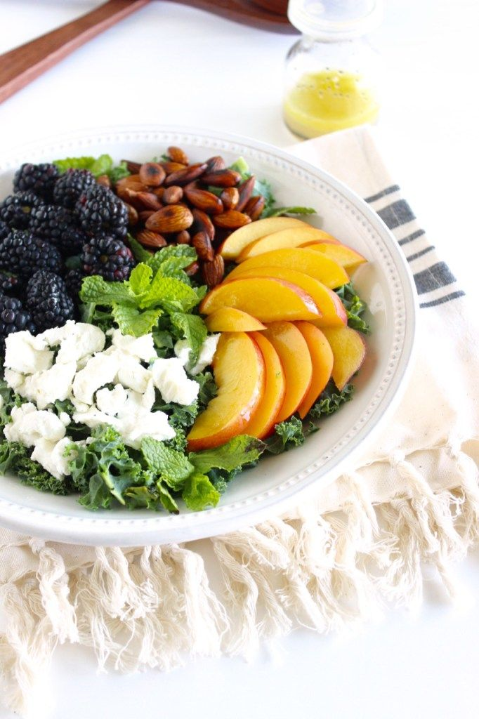 Blackberry Peach Kale Salad | A delicious fruity salad with toasted almonds, goat cheese, mint and a lemon poppy seed vinaigrette. It's a perfect light lunch or dinner side dish! (vegetarian, gluten-free) | Via livelytable.com @livelytable
