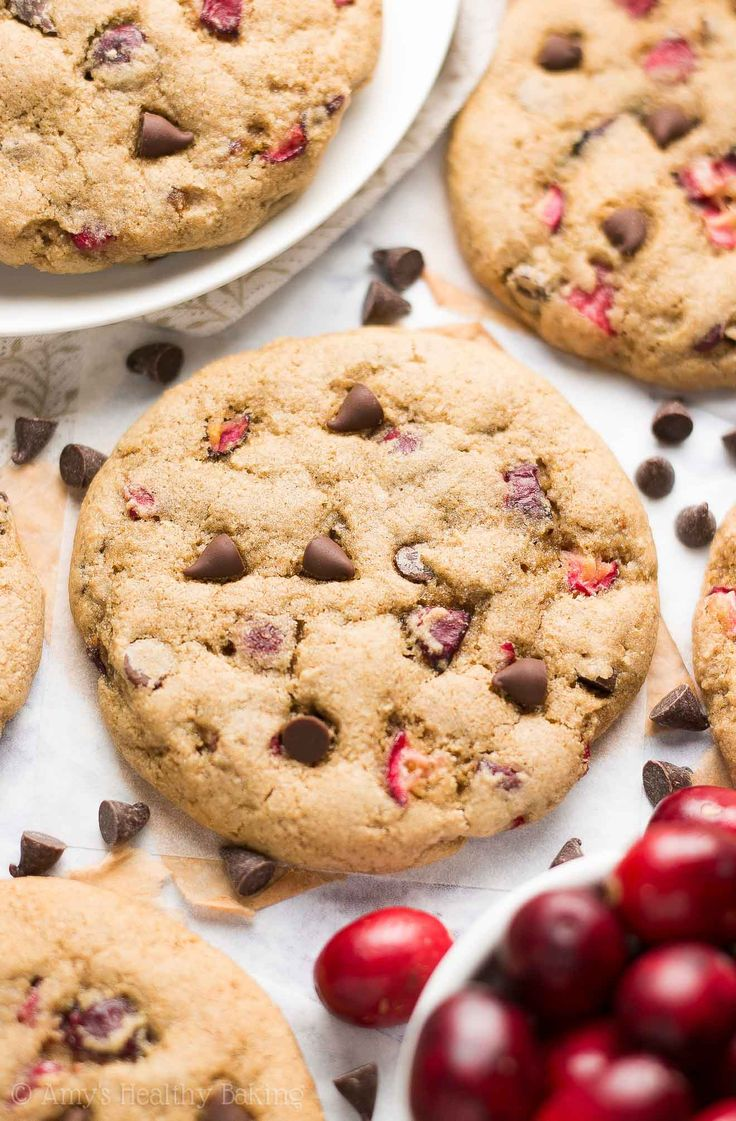 {HEALTHY!} Cranberry Chocolate Chip Cookies -- only 95 calories! Soft, buttery, chewy... Even with NO eggs, refined flour or sugar! Super easy to make too! Perfect for holiday parties & cookie trays! #recipe #healthy #vegan #christmas #holidaycookies