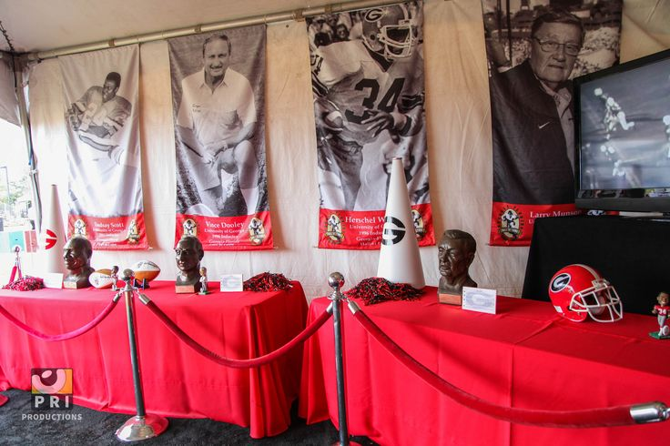 Georgia Bulldog table display with red linens and rope and stanchions. FL-GA Hall of Fame Exhibit 2013