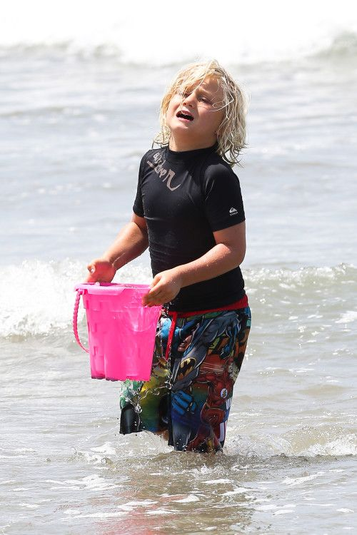 Gwen Stefani and Gavin Rossdale take their boys Kingston, Zuma and Apollo to the beach on June 21, 2014