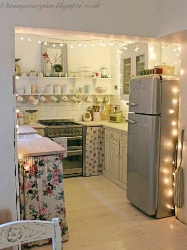 Open shelving, hanging cups, curtains, lights, vintage style fridge, subway backsplash. M.