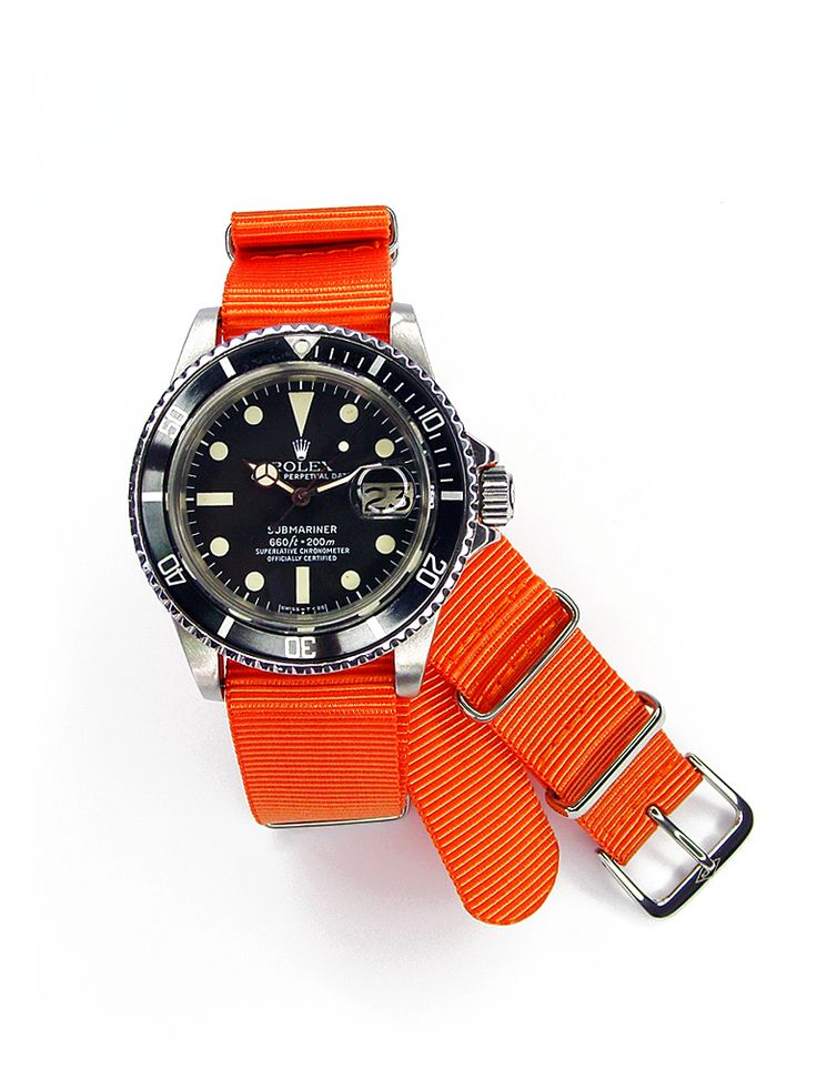Welcome To RolexMagazine.com...Home Of Jake's Rolex World Magazine..Optimized for iPad and iPhone: Rolex Studio Shot Of The Day: Raul's Submariner on an Orange NATO Strap Reference 1680