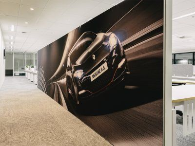 Large murals at Renault draw out the excitement of the brand.