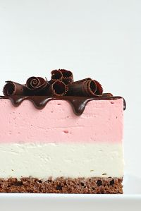 Napoletano Mousse Cake - A chocolate sponge cake with vanilla & strawberry mousse topped with chocolate ganache!
