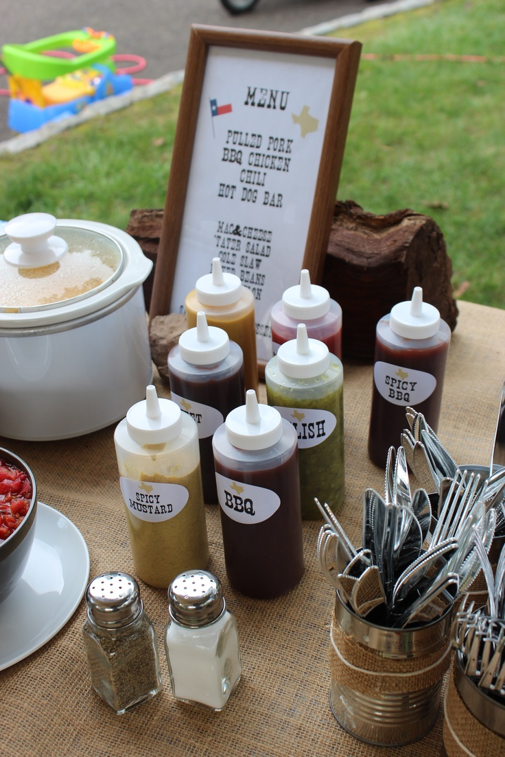 Western/Cowboy theme - Covered the condiments with custom stickers...Nashville font and a little texas outline.  Ordered the condiment holders online.
