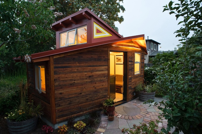 On a quaint, tree-lined street in Berkeley, California, architect Sarah Deeds of Deeds Design and carpenter John McBride placed a 120-square-foot office/art studio near their main house, a renovated 1906 Victorian, on a 3,100-square-foot lot.  Photo by Lenny Gonzalez