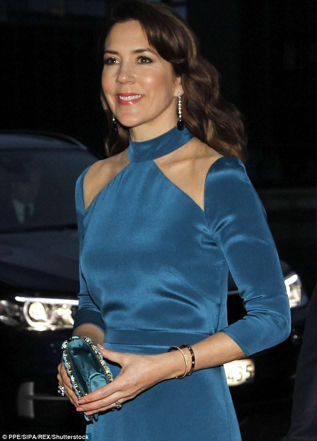 The Princess channelled Hollywood glamour in cobalt blue as she joined the Belgian royals ...