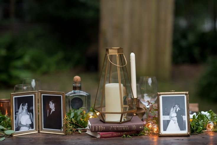 Love this table decor: old books, photographs, and candles! A Whimsical Woodland Inspired Vow Renewal via TheELD.com