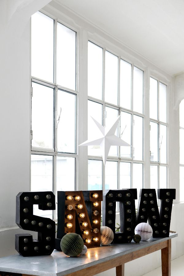 SNOW. I like this idea but I would paint the letters white and use mini Christmas lights for a softer effect.