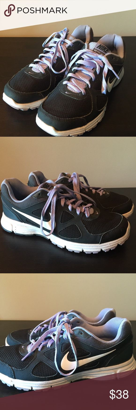 Nike Revolution 2 running shoes size 9 Almost new Nike Revolutions, pretty lilac purple and black. Worn just a handful of times. Nike Shoes Sneakers