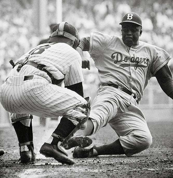 Jackie Robinson stealing home. He didn't just have to prove he belonged, he had to prove he was the best.