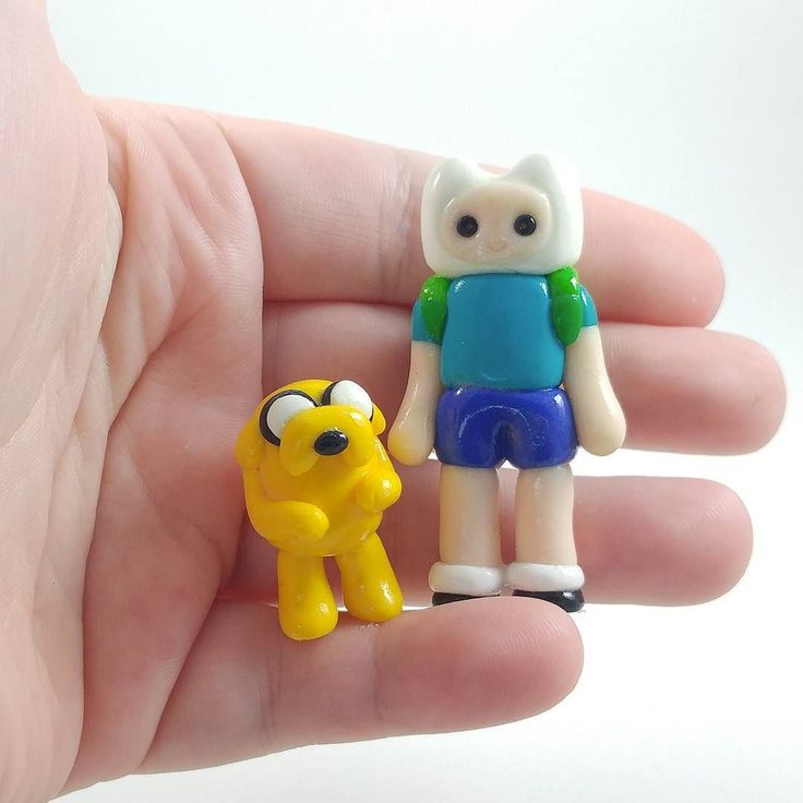 Fin and Jake are ready to go on an adventure with you! . . . . . .  #adventuretime #fin #jake #polymerclay #handmade #fanart #sculpture #kawaii #figurine #miniature #fairygarden #terrarium #cartoonnetwork #cartoon #caketoppers #adventure