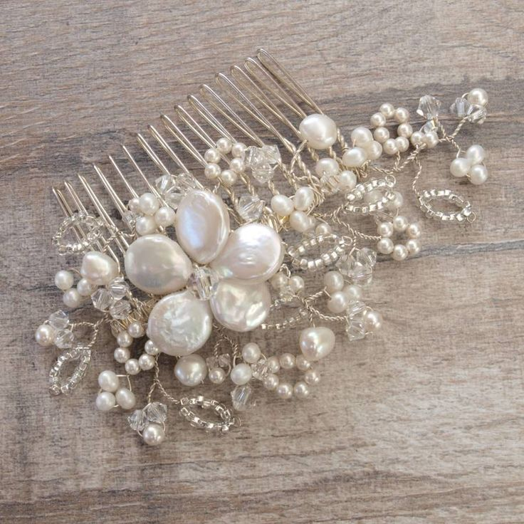 Are you interested in our Pearl Bridal Hair Comb? With our pearl Wedding Hair Accessories you need look no further.