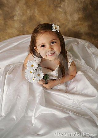 Take pic of your daughter in your wedding gown..and one day display it beside her REAL bridal portrait :) LOVE