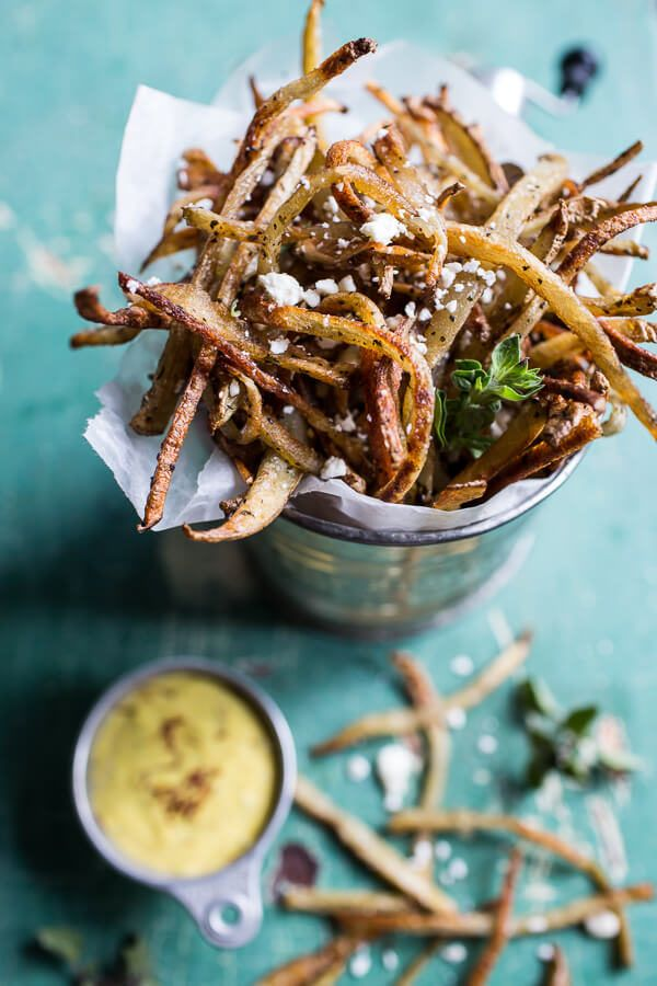 """For the fancier fry lover, these <a href=""""http://www.halfbakedharvest.com/skinny-greek-feta-fries-with-roasted-garlic-saffron-aioli/"""" target=""""_blank"""">Greek shoestring fries with a garlic saffron aioli</a> will do the trick."""
