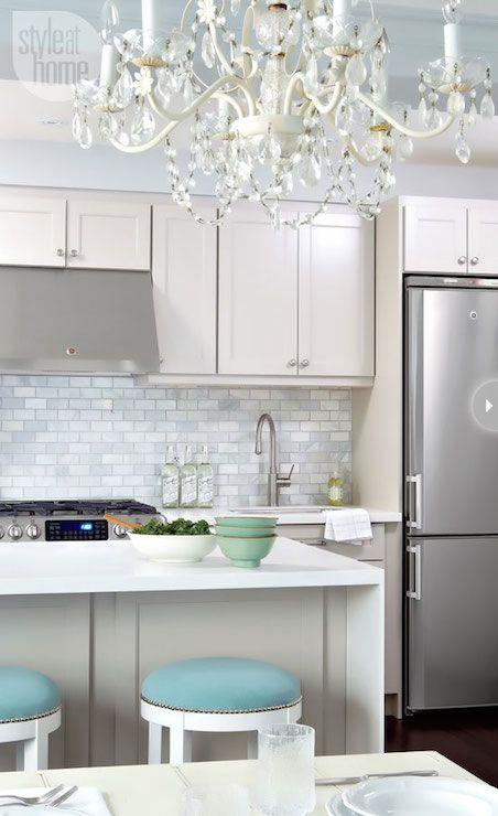 Style at Home - kitchens - corian counters, corian countertops, white corian, white corian countertops, kitchen peninsula ♥