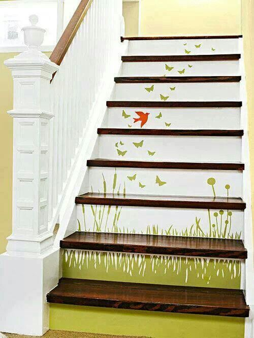 Stairs with mural and white banister