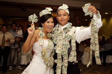 Cuban Money Dance.   During a Cuban wedding reception, each man that dances with the bride pins money on her dress to help the new couple with their honeymoon expenses.