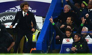Chelsea manager ANTONIO CONTE salutes his 'fantastica' team as they sweep to the Premier League summit...