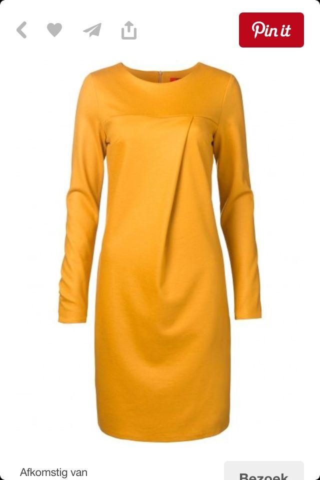 Lovely dress in the nice color ochreous.