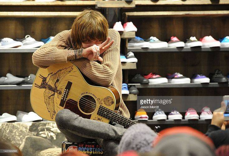Musician Christofer Drew of Never Shout Never performs at the Vans In-Store secret appearance for the iTunes launch of NO ROOM FOR ROCKSTARS Vans Warped Tour Film held at the Vans Store Third Street Promenade on April 3, 2012 in Santa Monica, California.