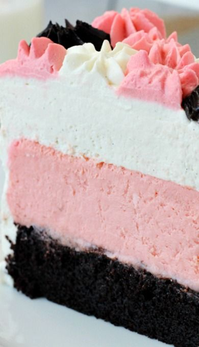 Neapolitan Millionaire Cake...with a chocolate cake on the bottom, strawberry cheesecake in the middle and vanilla bean mousse on top.  Classy and delicious!!