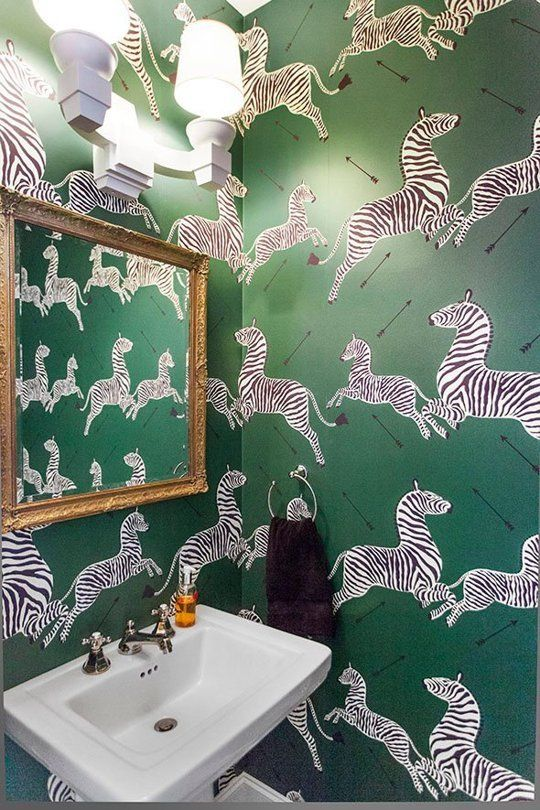 The zebra-filled wallpaper brings a sense of whimsy to this powder room. {image via apartment therapy}