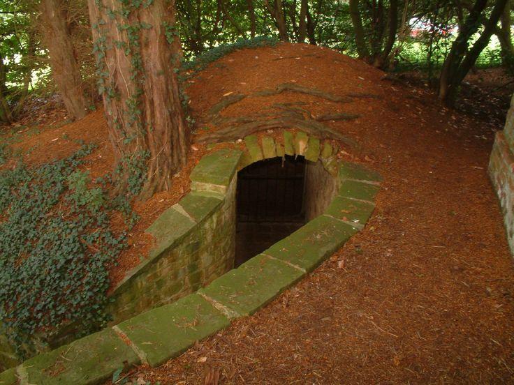 Neat construction for a hillside hidden outdoor room, hidden passage into house, or root cellar.