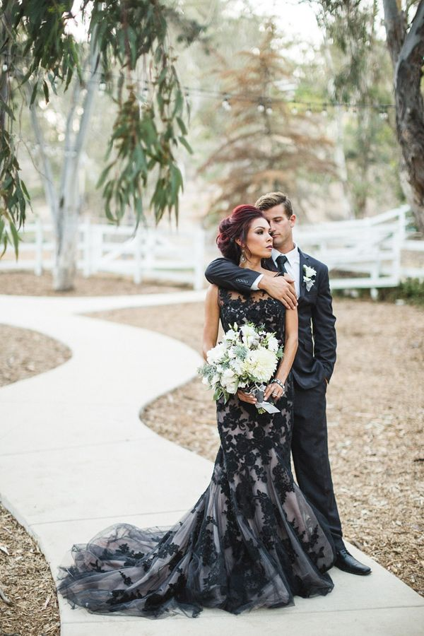 black lace wedding gown, photo by Analisa Joy http://ruffledblog.com/til-death-do-us-part-styled-wedding #weddingideas #weddingdress #blacklace