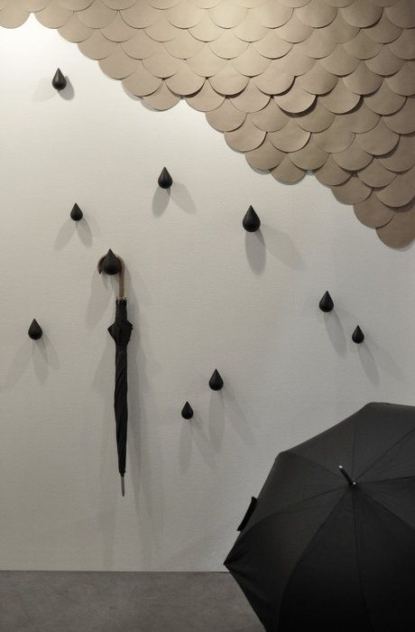 easy diy...scallop paper cloud using paper grocery bags. the wooden walls hooks are from Asshoff & Brogård Designstudio