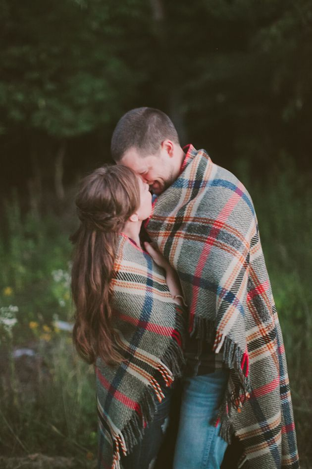 Cute and cosy engagement shoot shot - wrapped up in blankets