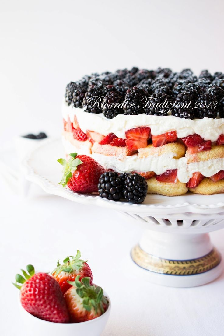 strawberry trifle with vanilla cream and blackberry topping
