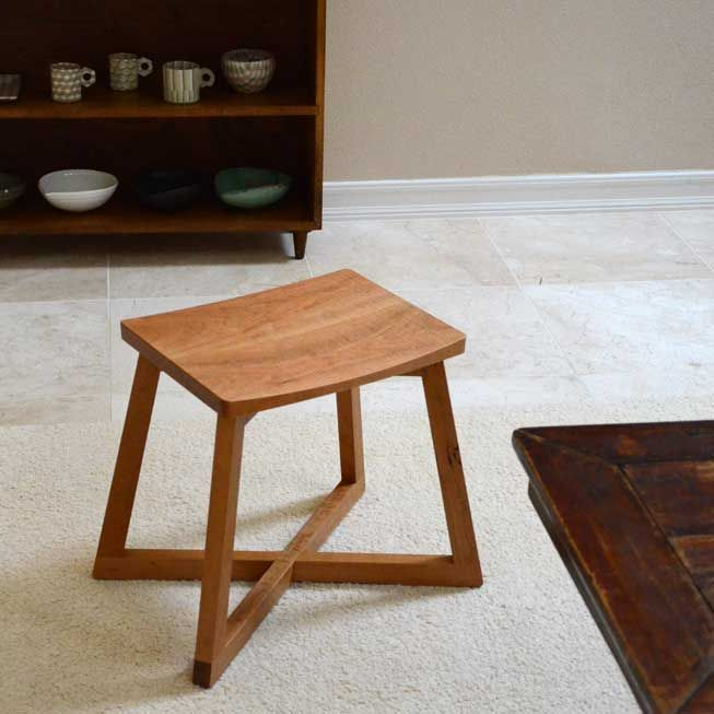 Slider Stool – Cherry. L20″ x W14″ x H16.75″ Cherry wood with plant-based oil finish. Handmade in Japan by Maeda Mitsuru