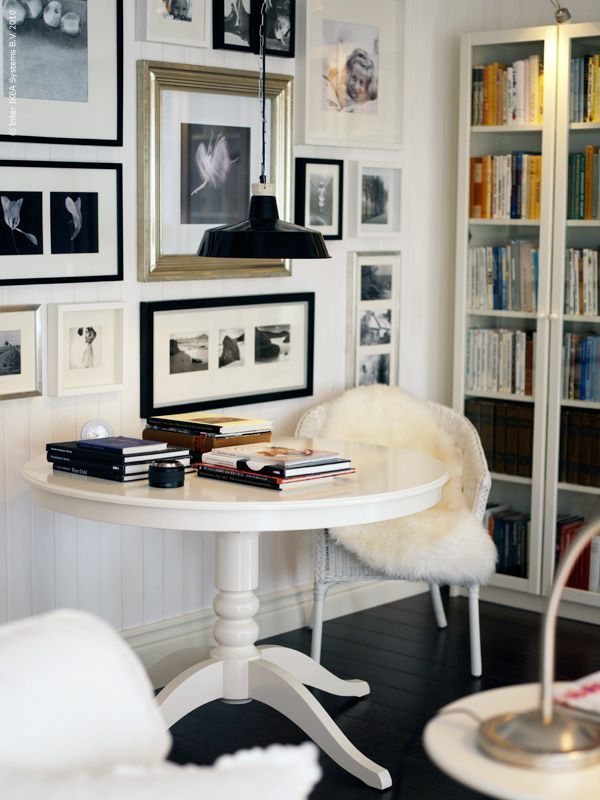 white table and glass door over book case to stop books from getting dusty!