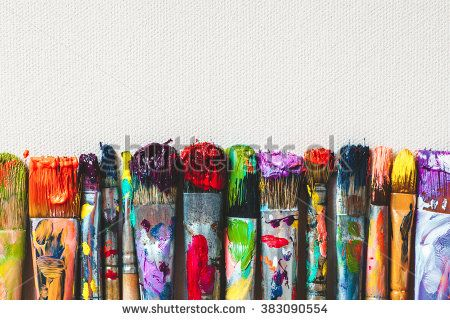 Row of artist paintbrushes closeup on artistic canvas. - stock photo