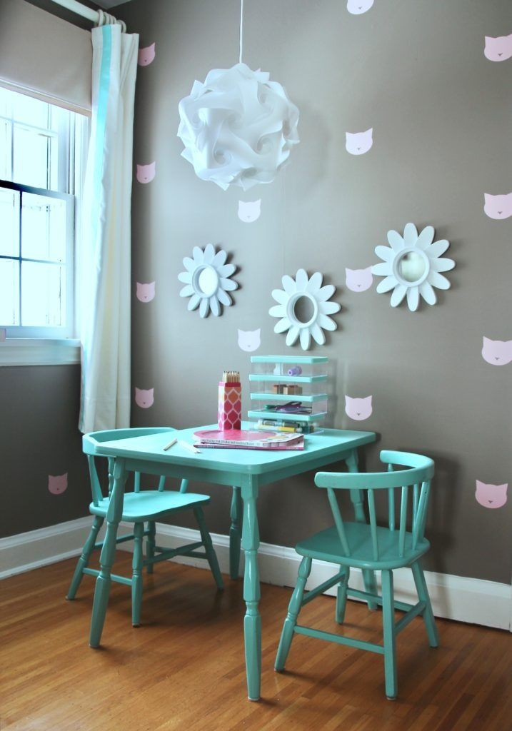 The Sherwin-Williams 2017 Color of the Year, Poised Taupe SW 6039, creates a totally versatile, earthy neutral backdrop, perfect for this little girl's bedroom makeover. Adorable pink kitty decals plus a table and chair with a fresh coat of Aqueduct SW 6758 complete the whimsical transformation. Great job, @MemeHillStudio!