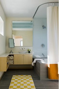 cool idea for a shower curtain that is more spacious than traditional rods for bath-shower combo - L-Trax