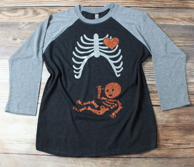 """Welcome to our shop! We're excited you're here! Just to reiterate, our """"Pregnant Skeleton"""" shirt is not a maternity shirt. It is unisex comfortable top. It could be a great pregnancy shirt if you choo"""