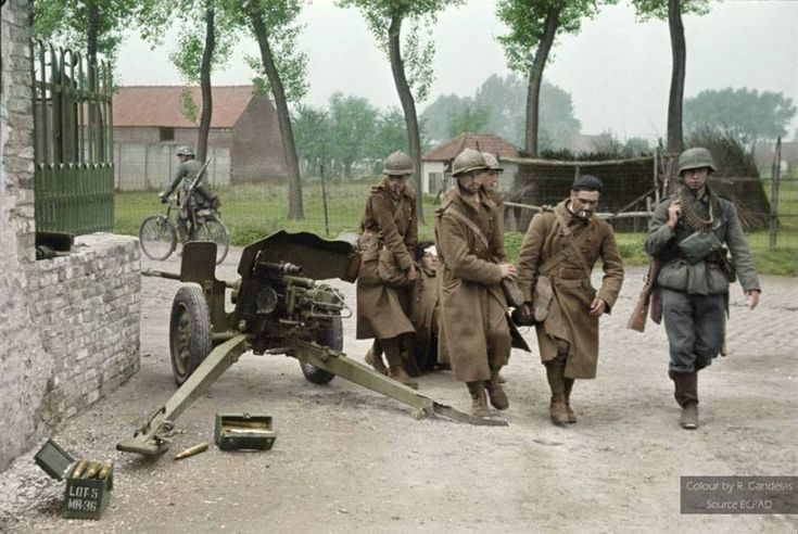 French troops carrying a wound comrade during the Battle of France. May 23, 1940