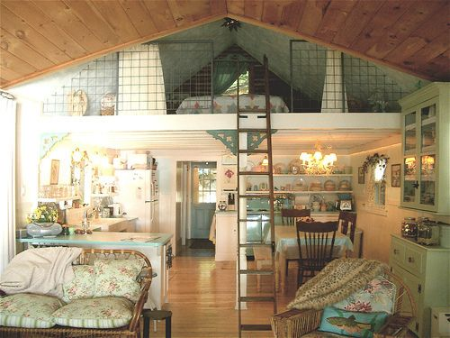 Sleeping Loft Antique porch posts help support the sleeping loft, reached by