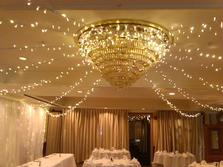 Close up of Hotel Coachman Chandelier  centerpiece with fairylight ceiling decoration Palmerston North 2013
