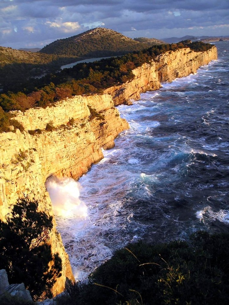 "The cliffs of The Telašćica Nature Park, or locally called ""stene"", rise up to 161 m above the sea, and fall down vertically to a depth of 90 m."