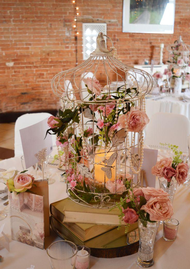 Stunning ivory birdcage centrepiece with pink pastel